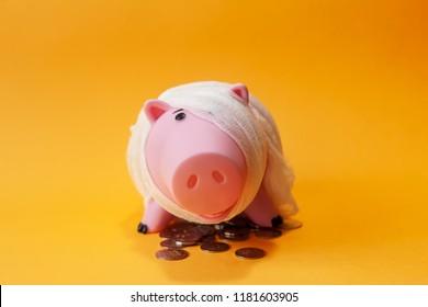 poor injured piggy bank toy