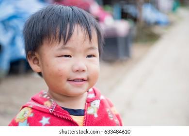 Poor little boy living on high mountain, Phu Thabberk, Wang Ban, Lom Kao, Phetchabun province, 5 Sep 2016