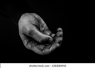 Poor Man holding coins, dirty hand