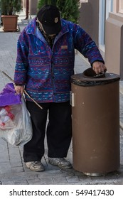Poor man  is looking in the trash in City of Tbilisi near the underground Marjanishvili.10/01/2016.
