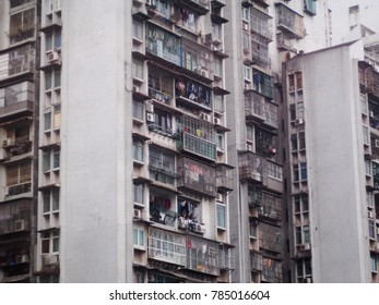 poor man resident high old grunge rustic apartment building small rooms unsafe life protection with danger metal cage fence around every balcony and windows in case of fire as dark side of large city