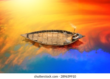Poor man riding old style boat on the river in bangladesh