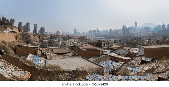 Poor part of chinese city with developed buildings in the background