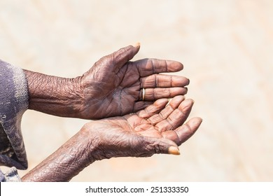 Poor people and human poverty concept - person hands begging for food or help