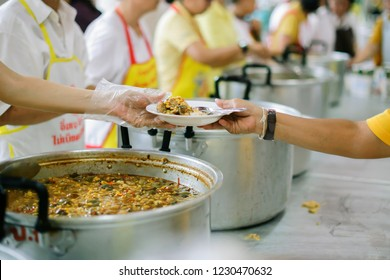 Poor people receive donated food from donors, Demonstrate mutual sharing in today's society : the concept of helping the needy