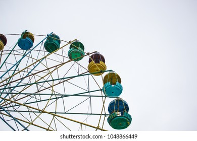 Poor and ruined ferris wheel with white space for copy or text