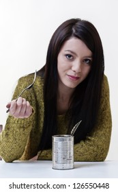 poor student eating cold food from the tin