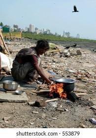 poor woman cooking her meal