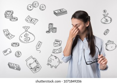 Poor woman. Emotional sad student closing her eyes and feeling terrible while having no money for her education