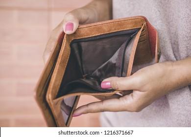 poor woman hand open empty wallet looking for money having problem  bankrupt ,broke concept