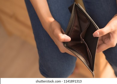 poor woman without money, empty wallet; portrait of poor woman with empty wallet, poor people, poverty, bankruptcy, financial broke, unemployment, no credit concept; asian young adult woman model