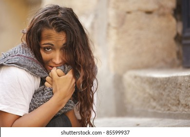 poor young woman in cold weather