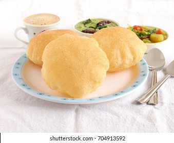 Poori, also known as Indian fried bread, is a traditional and popular Indian vegetarian food, usually made for breakfast or lunch, with potato curry and coconut chutney as side dishes.