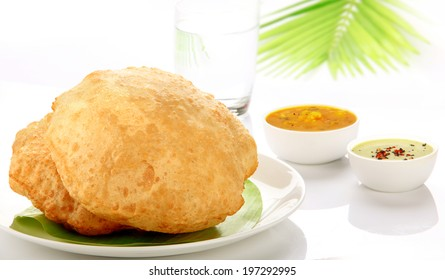 Poori Saagu - Delicious deep fried poori (puri) served with spicy potato onion curry (saagu) and chutney