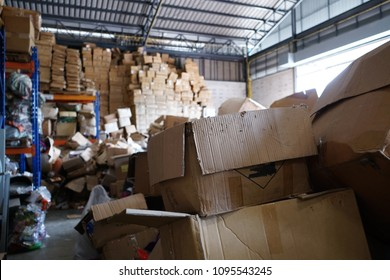 Poorly organized warehouse with a lot of messy stocks and boxes