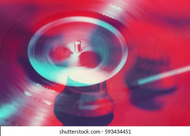 Pop Art Double Exposure Photograph of Vinyl Record Spinning and Electric Guitar Knobs