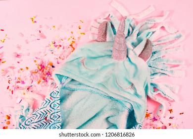 pop art fluffy unicorn pajamas on pastel pink colour background.