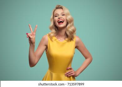 Pop art portrait of smiling beautiful woman against blue background