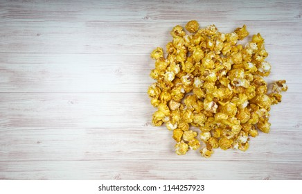 Pop corn on wooden table