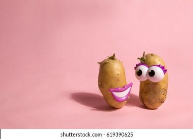 a pop and minimal potato portrait on a pink background
