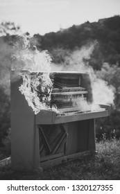 Pop music, melody, rhapsody, looting. Piano on fire, keyboard, smoke. Fire, art, Halloween, trash, bonfire. Burning piano, musical style, grunge instrument. Rock concert, jazz, fireplace, destruction.
