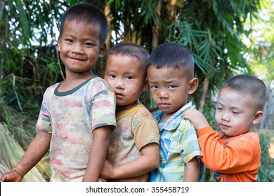 POP PRA, TAK, THAILAND - DECEMBER27, 2015 : Unidentified group of Akha ethnic kids are playing together at KM48, Pop Pra, Tak, Thailand.