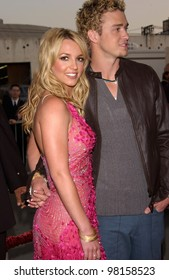 Pop star BRITNEY SPEARS & boyfriend JUSTIN TIMBERLAKE of NSYNC at the American Music Awards in Los Angeles. 09JAN2002.   Paul Smith/Featureflash
