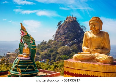 Popa mountain in front with golden Buddha near Bagan, Myanmar