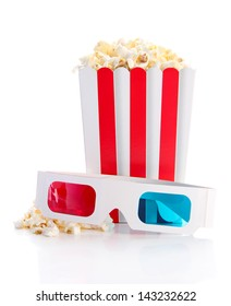 Popcorn and 3D glasses, isolated on white
