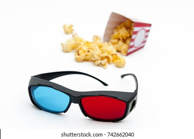 Popcorn and 3D glasses, to see the 3D movie on a white background.