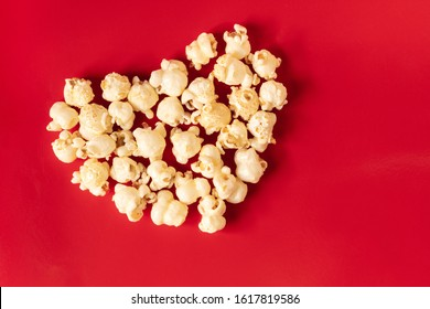popcorn blast heart shape with corn on red  isolated
