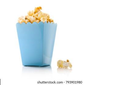 Popcorn in blue bucket on white background
