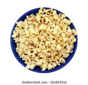 Popcorn in a blue plate closeup
