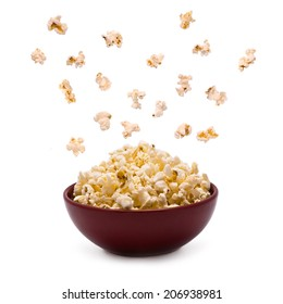 Popcorn in the Bowl explodes isolated on white