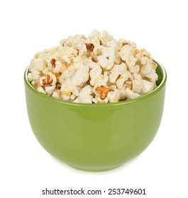 Popcorn in a bowl isolated on white background