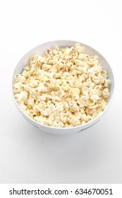 Popcorn in the bowl on white background - Soft focus