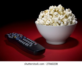A popcorn bowl and a remote control ready for fun.