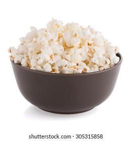 Popcorn in a brown bowl on a white background