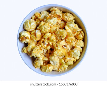 Popcorn butter coating in a white ceramic bowl, top view isolated ,On a white background