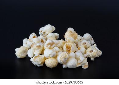 Popcorn with Caramel  isolated on black background
