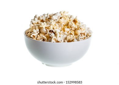 Popcorn in ceramic bowl on isolated white