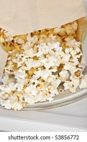 Popcorn cooked in a microwave oven still in  the bag.