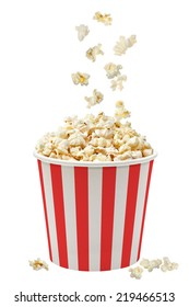 Popcorn falling in striped bucket isolated on white background