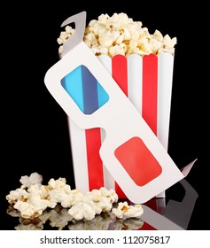 popcorn and glasses isolated on black