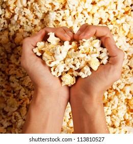 popcorn in hand