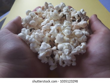 Closed cell spray foam insulation on stock photo edit now popcorn in the hands on yellow background altavistaventures Image collections