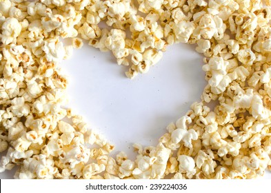 Popcorn Heart , Heart shaped frame made of popcorn over the white background