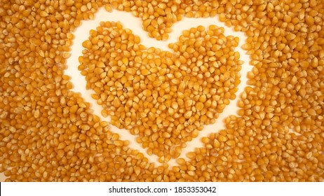 Popcorn maize heart. Dry pop corn. Healthy eating. Yellow grain agriculture