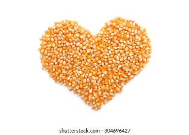 Popcorn maize in a heart shape, isolated on a white background