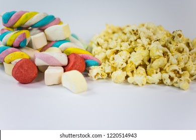 popcorn and marshmallow on white background